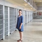 My wife posing near one of the prison cell blocks.