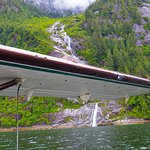 Water-level view of spectacular Misty Fjords waterfall....