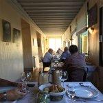 Le plateau de fromage, un excellent Faugeres et la salle de restaurant sur la Dourbie.