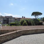 Standing on the wall surrounding the entire town of Lucca looking into fabulous villa gardens