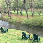 Relax on our adirondack chairs overlooking the brook!