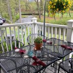 Patio dining overlooking Hop Brook