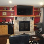 The wet bar and fireplace/sitting area