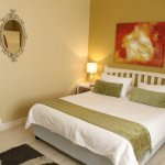 Standard Room with en-suite bath and shower. Room has a Queen sized and Single bed.