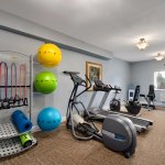 24 hour fitness room with pilates and yoga bar.