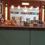 Counter of old candies. Note th eold fashioned painted, pressed tin ceiling!