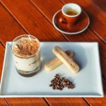 Tiramisu - Sponge finger biscuits dipped in whiskey and coffee and layered  with a light masc