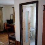 """A """"deluxe"""" room; hardwoods, desk/vanity, armchairs, AC, beautiful bathroom."""