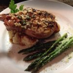 Our grilled 10-oz pork chop is cooked to perfection.