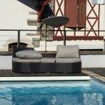 Terrasse côté piscine de la  Maison Maxana