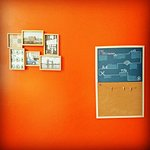 Photos and display board in room