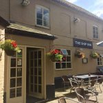 Front of pub with hanging baskets