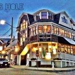 Quicks Hole Tavern sits like a ship next to the ships of Woods Hole harbor.