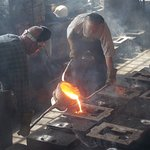 Pouring molten metal into the moulds.