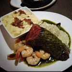 Hanger steak with a chimichurri sauce, blue cheese sauce, butter poached shrimp, homemade smoked