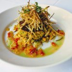 Jumbo lump crab cake, cream corn, shoestring potatoes, green tomato chow chow