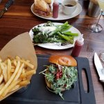 Lamb burger (foreground), Shaved prime steak sandwich w/charred lemon parmesan broccolini