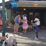 Daisy Duck greeting happy people