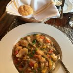 My shrimp and grits. Delicious biscuits too.