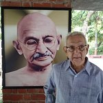 Dad with Gandhiji's photo in the background