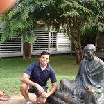 With Gandhiji's statue