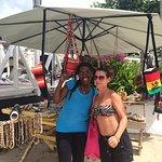 Lovely Celeste selling trinkets on beach by hotel