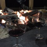 Wine by the fire on the second floor balcony!