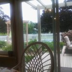 View from breakfast sun room to deck toward pool enclosure