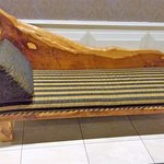 Lovely carved lounger as you enter the Dining Room.