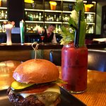 Bloody Mary's Bar-Lounge-Grill - Signature cocktail and beef burger
