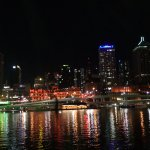 This is a night time view from South Bank to the Brisbane city centre