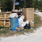 garbage piled up right outside the cottages