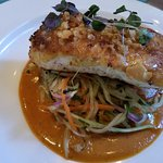 Macademia, panco crusted halibut with red curry/peanut/passion fruit sauce