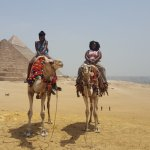 Outside the Giza Pyramids riding the Cames