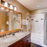 Guest bathroom with shower tub combo and granite counters