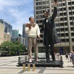 "A larger version of American realist Seward Johnson's ""Return Visit"" sculpture"