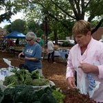 Sheryl selects fresh vegetables from the local farmer's market for our menu items.