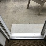 """two steps to the patio in the """"wheelchair accessible"""" room"""