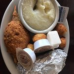 $14. Grits, one fried deviled crab, about 6 fried scallops, 2 hush puppies, one sweet potato.