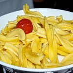 Side dish of accompanying pasta in chafing dish