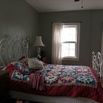 Room 1 - Cozy queen bed with historic look. Slept like a dream.