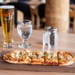 Flatbread pizza complete with a Steamworks Pale Ale