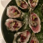 oysters served with pickled elderberry and smoked grapeseed oil