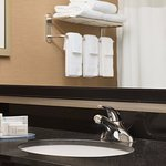 Guest bathroom with complimentary toiletries and fresh, fluffy towels.