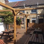 Beer garden, showing the back of the pub.