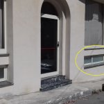 The circled small window is the only window in room 2108 next to the road and back door.