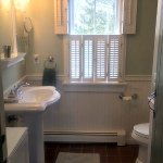 Nantucket cottage bath room with tiled shower stall.
