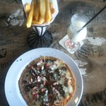 No pizza is ever alone with perfectly fried fries and virgin pina colada