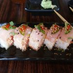 Kicker Roll - spicy crab, spicy tuna, avocado inside with yellowtail outside