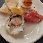 Painted Lady Oyster and Prosciutto with deviled egg